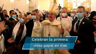 Ante la iglesia de San José, en Bagdad, los pocos cristianos que obtuvieron una invitación para asistir a la primera misa papal de la historia de Irak rompen brutalmente su silencio