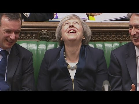 Theresa May gets the giggles during PMQs