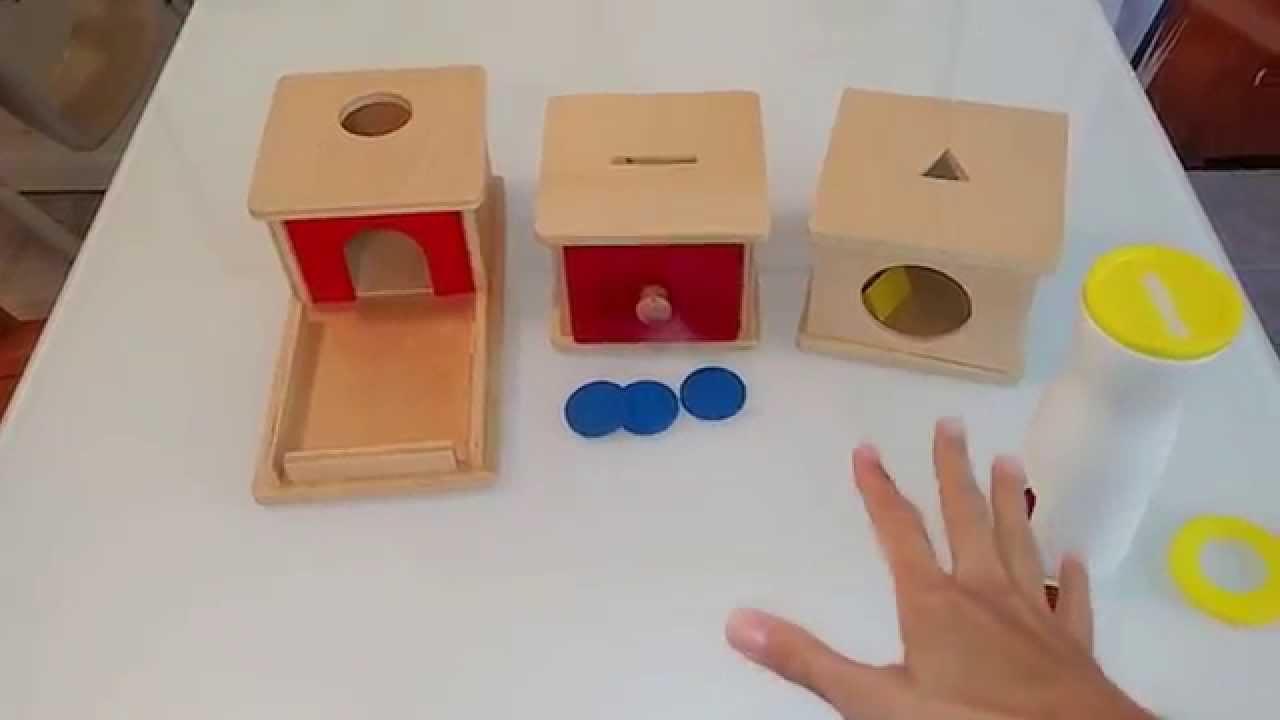 Infant montessori activities object permanence fine motor for Montessori fine motor skills