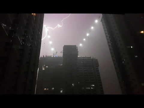 Lightning Striking A Crane At SM Grass Residence In Quezon City.