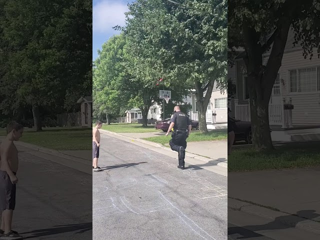 Police officer does World's Largest Hopscotch to make kids smile