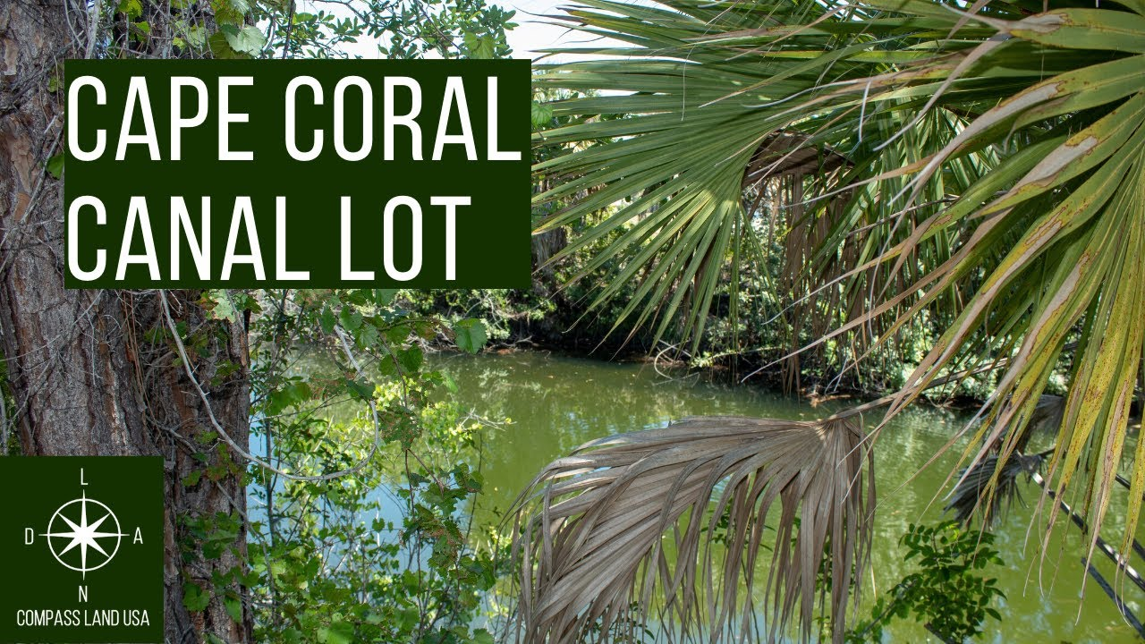 Sold by Compass Land USA - Cape Coral Quarter Acre Land - On Canal!