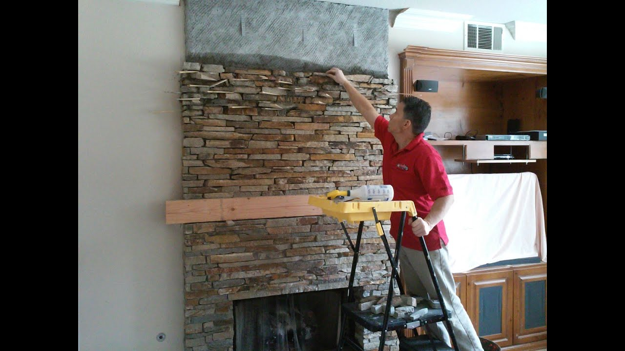 http://www.RockTheFireplace.com/ pt 2 Stone Fireplace featuring New Wood Mantle. Thin Natural Stone Veneer Installation. The veneer is typically 1 inch thick...