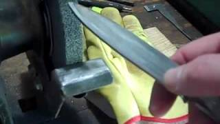 Shaping the bevel on a bench grinder