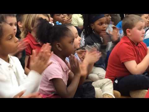 The Flint Troubadours perform at area elementary school