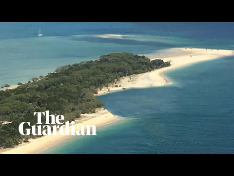 Sinkhole opens up on Queensland beach