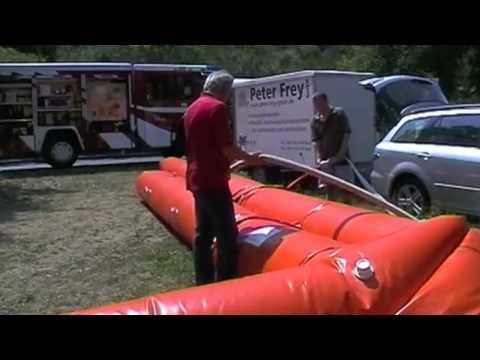 Beaver inflatable mobile flood barrier deployment