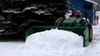 big snow pusher -  little tractor