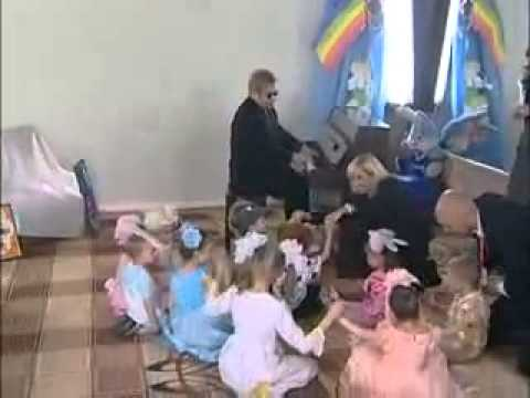 Elton John plays piano and sings Circle of Life for orphan children in Ukraine