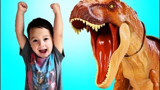 Father & Son play with toy Jurassic World Colossal Tyrannosaurus Rex