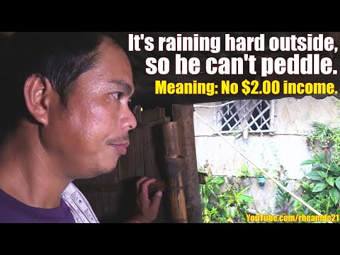 This Poor Filipino Father of 6 Can't Peddle Because It's Raining Hard. POVERTY in the PHILIPPINES.