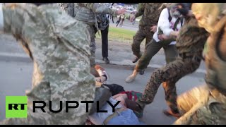 Violent Video: Intense clashes erupt as activists trash construction site in Kiev(Clashes broke out between dozens of protesters and police aided by 'hired thugs' as they attempted to trash a construction site planned for a shopping center in ..., 2015-05-20T00:59:28.000Z)