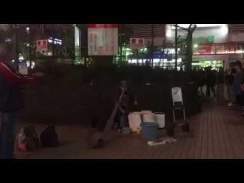 Street performers drumming in Japan