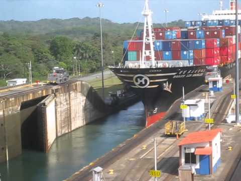 Cargo container ship going through Panama Canal locks