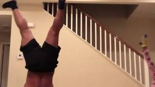 Daddy Cool: Girl Defeats Dad in Handstand Challenge