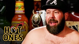 Download Bert Kreischer Sweats Profusely Eating Spicy Wings | Hot Ones Mp3 and Videos