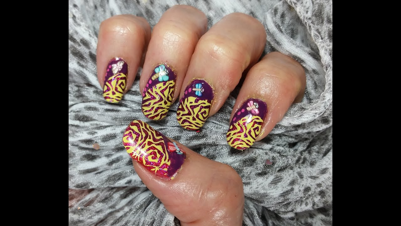 Stamped nail art design cute dragonflies on holographic purple