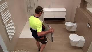 видео Водостойкий ламинат для ванной комнаты: как выбрать влагостойкий ламинат в ванную?