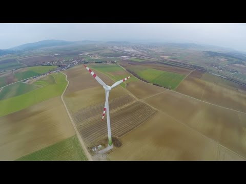 Panorama of wind turbine on green field in countryside. Energy self-sufficiency. Stock Footage