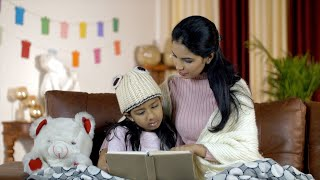 Beautiful Indian mother and daughter spending quality time together at home