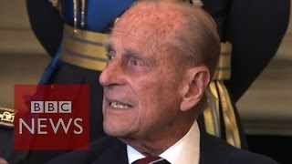 Prince Philip swears during photocall - BBC News