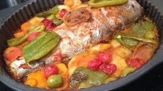 Poisson au four à la marocaine, aux légumes. Coût: 40 Dhs pour quatre personnes