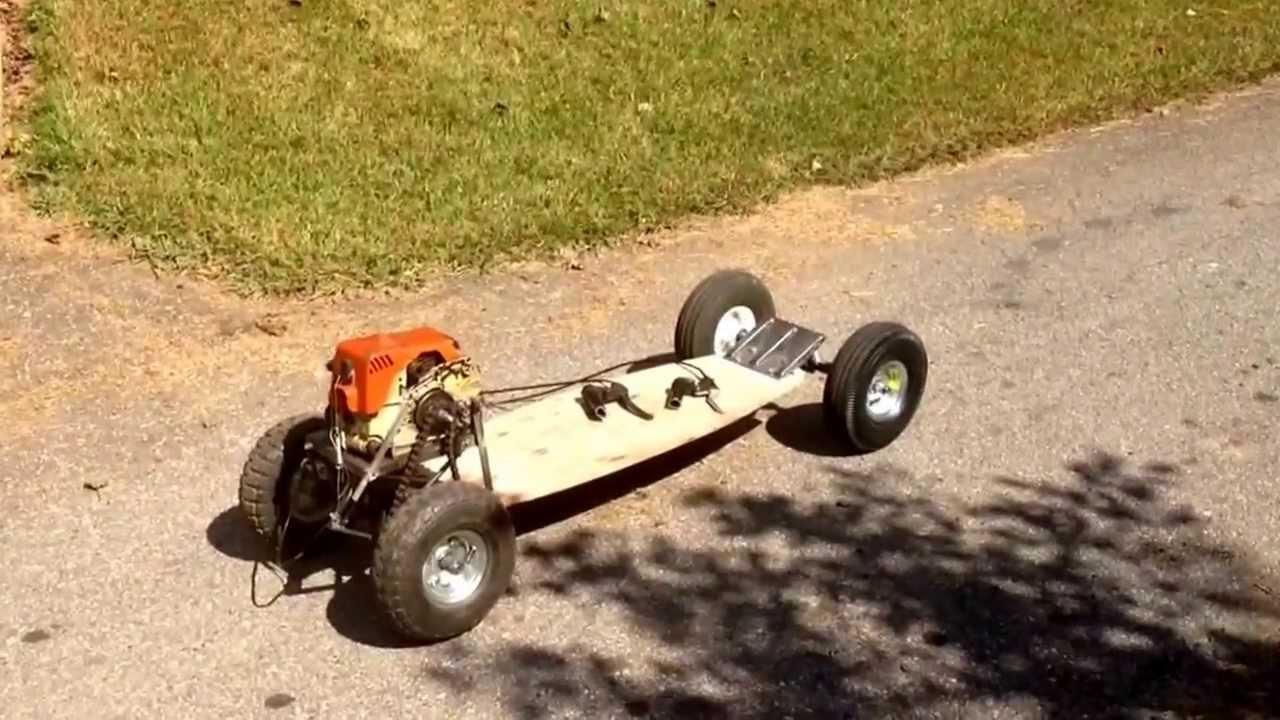 Home Made Chainsaw Powered Skateboard 30cc Youtube