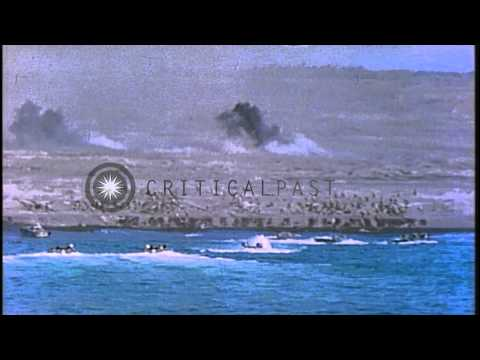 Bombing and firing at a beach and Mount Suribachi in Iwo Jima, Japan by US Marine...HD Stock Footage
