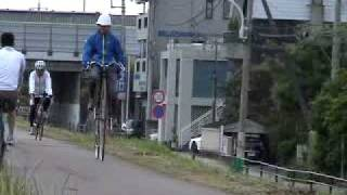 Ridding Penny Farthing with Pith Helmet