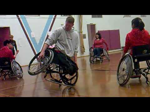 Patrick Anderson playing with his wheelchair