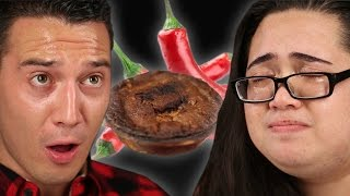 "People Try The ""World's Hottest"" Meat Pie"