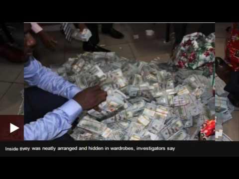 Nigeria's Buhari suspends spy chief after $43m found in Lagos