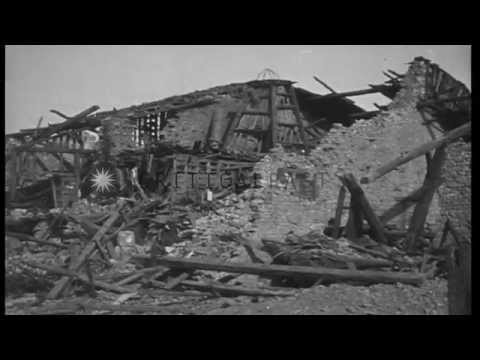 Wreckage of trees, buildings, churches, and a view of troop trenches in France...HD Stock Footage