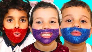 Sami draws a glitter beard on the face , اللحية اللامعة على الوجه