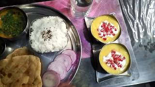 Tasty tandoori parathe in lunch with refereshing mango juice/ Indian Thali