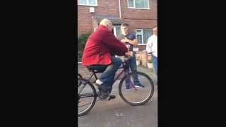 Grandad On a bike that turns the opposite way !!