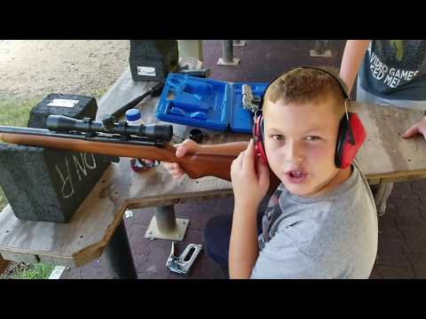 Kid shoots the 45 1911 and the 22 magnum, hunting