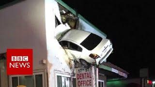 Dashcam captures a Car crashes into building in California - BBC News thumbnail