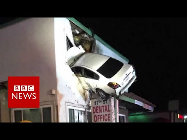 Dashcam captures a Car crashes into building in California - BBC News