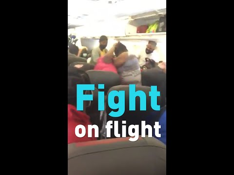 Watch American Airlines Passengers Fight On A Plane Over Masks.