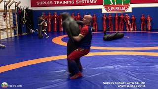 Coach Ivan Ivanov at age 50  challenges his young wrestlers with interval body lock throws
