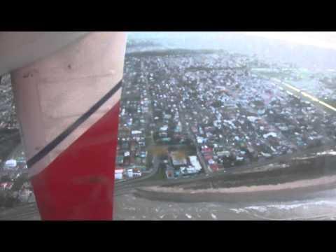 Tourist landing over Georgetown, Guyana