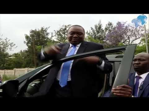 President Uhuru Kenyatta causes a commotion outside Uhuru Gardens Primary School