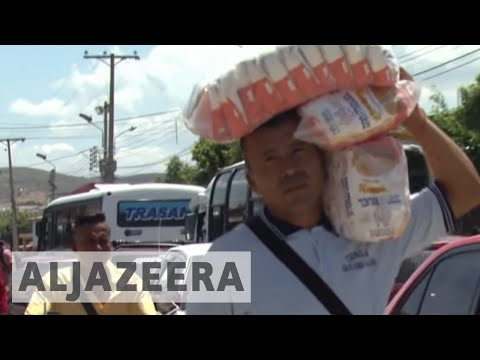 Venezuela crisis: Thousands cross into Colombia for food and medicine