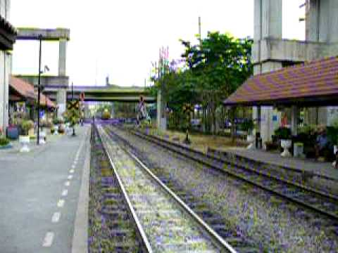 Cement trains passing Lak-Si Station. (Thailand)