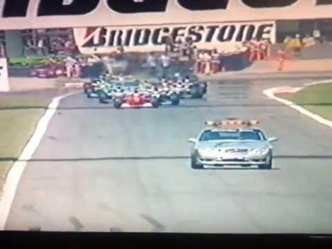 Michael Schumacher catching Jenson Button out at the Italian GP restart 2000