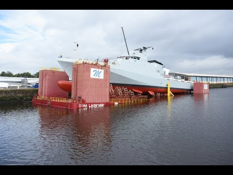 Royal Navy's new offshore patrol vessel HMS Forth being lowered into the water for the first time