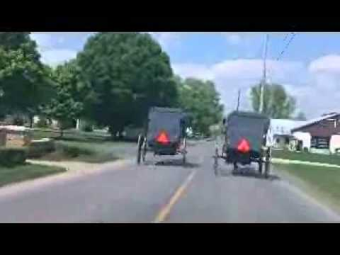 Amish Kids Racing with Carriages