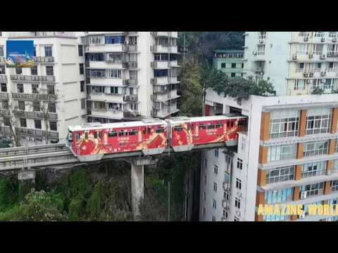 Chinese train that goes THROUGH a block of flats : Astonishing video : Chongqing Mountain City