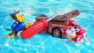 Paw Patrol toys in a pool at the water park: Chase and Marshall help Zuma